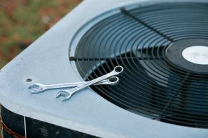 outdoor-ac-unit-with-tools-on-top