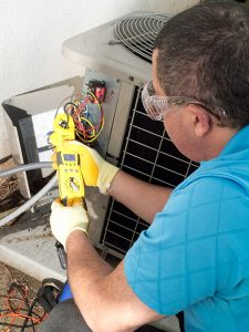 hvac-technician-making-ac-repairs