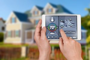 wi-fi-thermostat-in-foreground-with-house-background